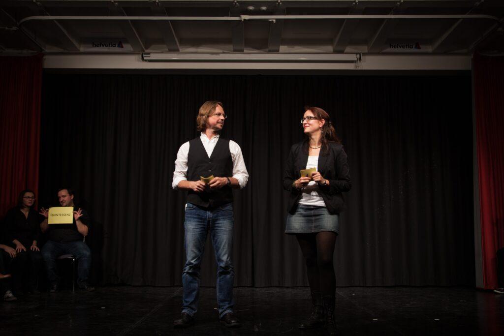 The teaching team as moderators at an Impro Championship in Vienna (Photo: © Mirella Rusch)