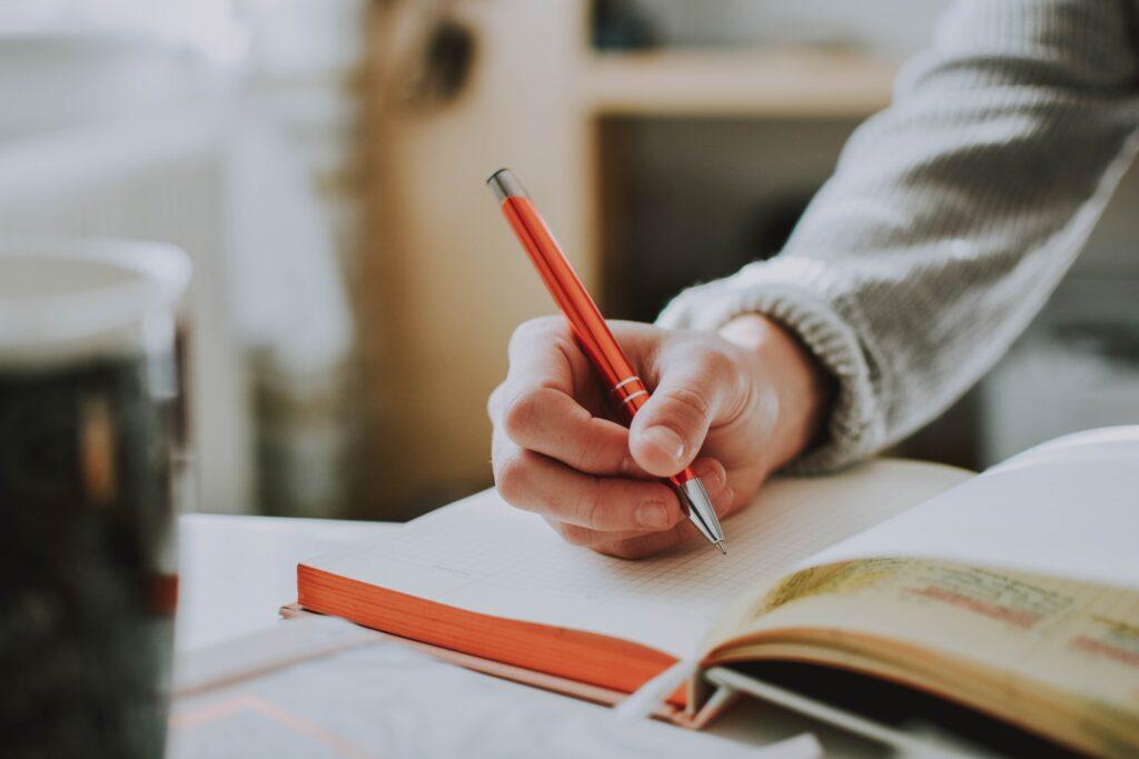 Schreibende Hand Notizbuch